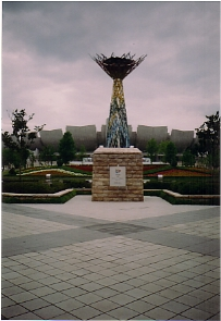 The Olympic Cauldron, with the stadium in behind